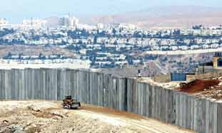 The West Bank security barrier is an example of th