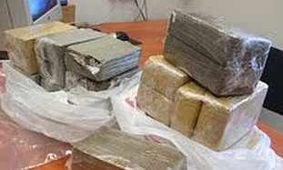 Police display the captured hashish.