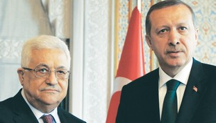 PA PRESIDENT Mahmoud Abbas stands with Turkish Pri