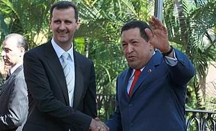 Venezuela's President Hugo Chavez shakes hand with