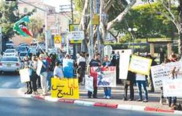 PEOPLE DEMONSTRATE against planned national-religious housing in Jaffa yesterday