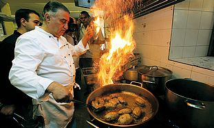 NOT YOUR everyday menu. Gourmet chef Moshe Basson prepares bulls' testicles at the Eucalyptus restau