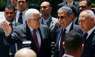 Palestinian President Mahmoud Abbas, left, Arab League Secretary General Amr Moussa, center and Egyp