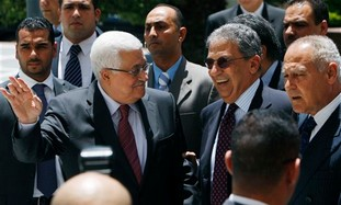 Palestinian President Mahmoud Abbas, left, Arab League Secretary General Amr Moussa, center and Egyp