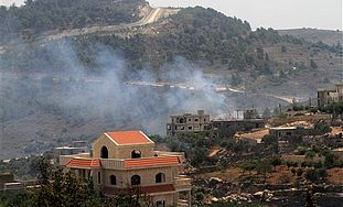 Smoke rises from the southern border village of Adaisseh after an exchange of fire between Israeli a