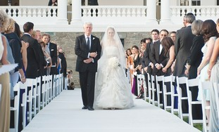 FORMER PRESIDENT Bill Clinton walks his daughter Chelsea down the aisle on July 31 in Rhinebeck, New