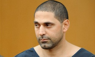Elias Abuelazam, 33, attends an extradition hearing in Fulton County Superior Court on Friday, Aug.