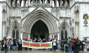 Demonstrators from the BDS group 'Al Haq' rally outside the Royal Courts in London,