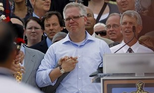 "Glenn Beck, center, holds hands with faith leaders at the ""Restoring Honor"" rally in front of the Li"