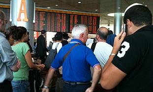 Passengers at Ben Gurion airport, Monday