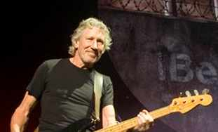 Roger Waters performing.