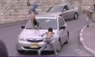 Settler leader hits rock throwing youths with car