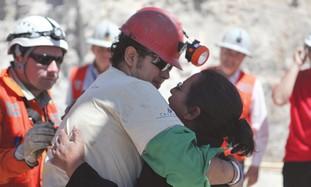 miner Daniel Herrera Campos embraces his mother af