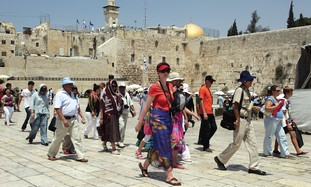 TOURISTS AT Jerusalem's Western Wall. The OECD con