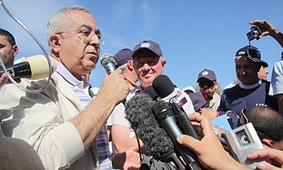 Fayyad speaks to reporters in the West Bank, Tues.