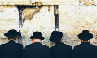 Haredim praying at Kotel