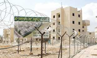 NEW HOMES go up in Betar Illit, 8 km. southwest of