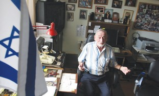HARRY GLUCKMAN sits in his home in Alameda, Califo