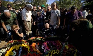 Mourners gather around the grave of Eran Weizel