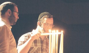 ACTOR ELIEZER CHAITOWITZ lights the hanukkiya