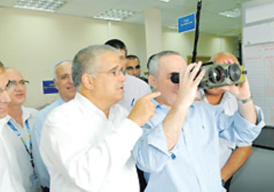 Finance Minister Yuval Steinitz looks through nigh