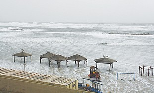 The sea engulfs Tel Aviv's Gordon Beach yesterday.