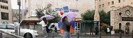 The storm knocks over a Jerusalem streetsign