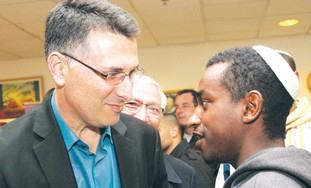 EDUCATION MINISTER Gideon Sa'ar speaks with a stud