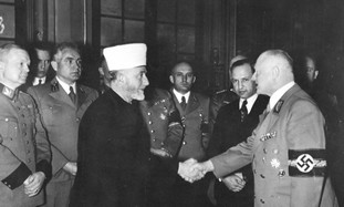 HAJ AMIN AL-HUSSEINI greets a WW2 Nazi official