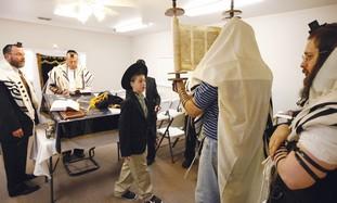 Morning prayers at a synagogue in Dallas.