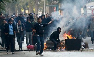 protesters chant slogans in Tunis