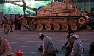 Protesters pray in front of tank in Cairo