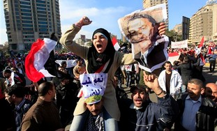 An Egyptian pro-Mubarak supporter in Cairo, Wed.