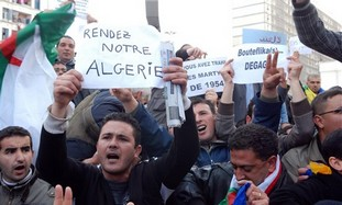 Algerian protesters holding posters