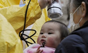 A baby is tested for radiation in northern Japan.