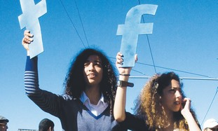 Moroccan women holding Facebook signs at protest