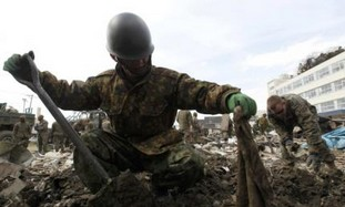 Japanese soldier searches for bodies