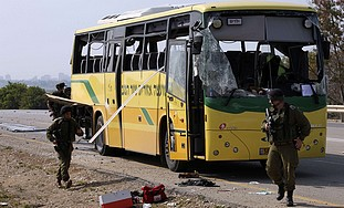 Damaged bus hit by an anti-tank missile, Thursday