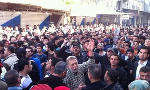 Syrians demonstrate after Friday prayers, Latakia.