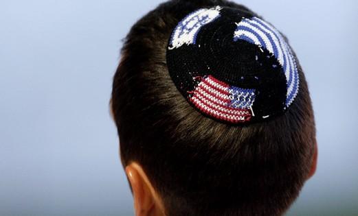Boy wearing American and Israeli flags Kippa