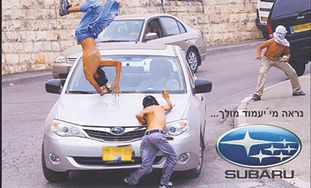Ad showing car hitting kids with Subaru logo.