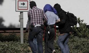 German police escort a suspected al Qaida member