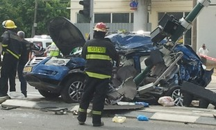 A wrecked car on Bar Lev Street, Tel Aviv.