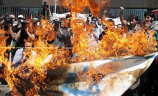 Nakba protesters in Istanbul burn an Israeli flag
