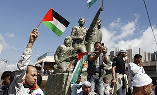 Syrians hold Palestinian flags in Majdal Shams