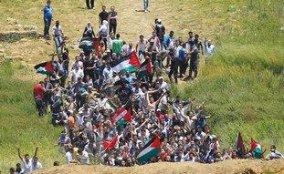 Syrians walk toward border near Majdal Shams, Sun.