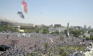 Pro-Assad demonstrators gather in Damascus.