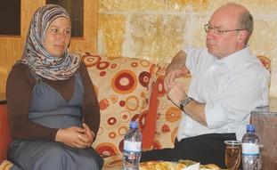 Alistair Burt speaks with wife of protest activist