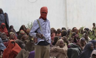 Al-Shabaab fighter at  food distribution camp