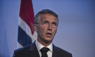 Norway's PM Jens Stoltenberg talks to reporters.